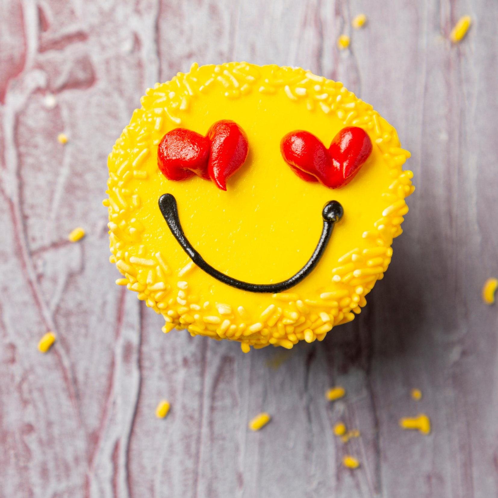 Yellow smile cupcake with red heart eyes depicting Nutrition Counseling