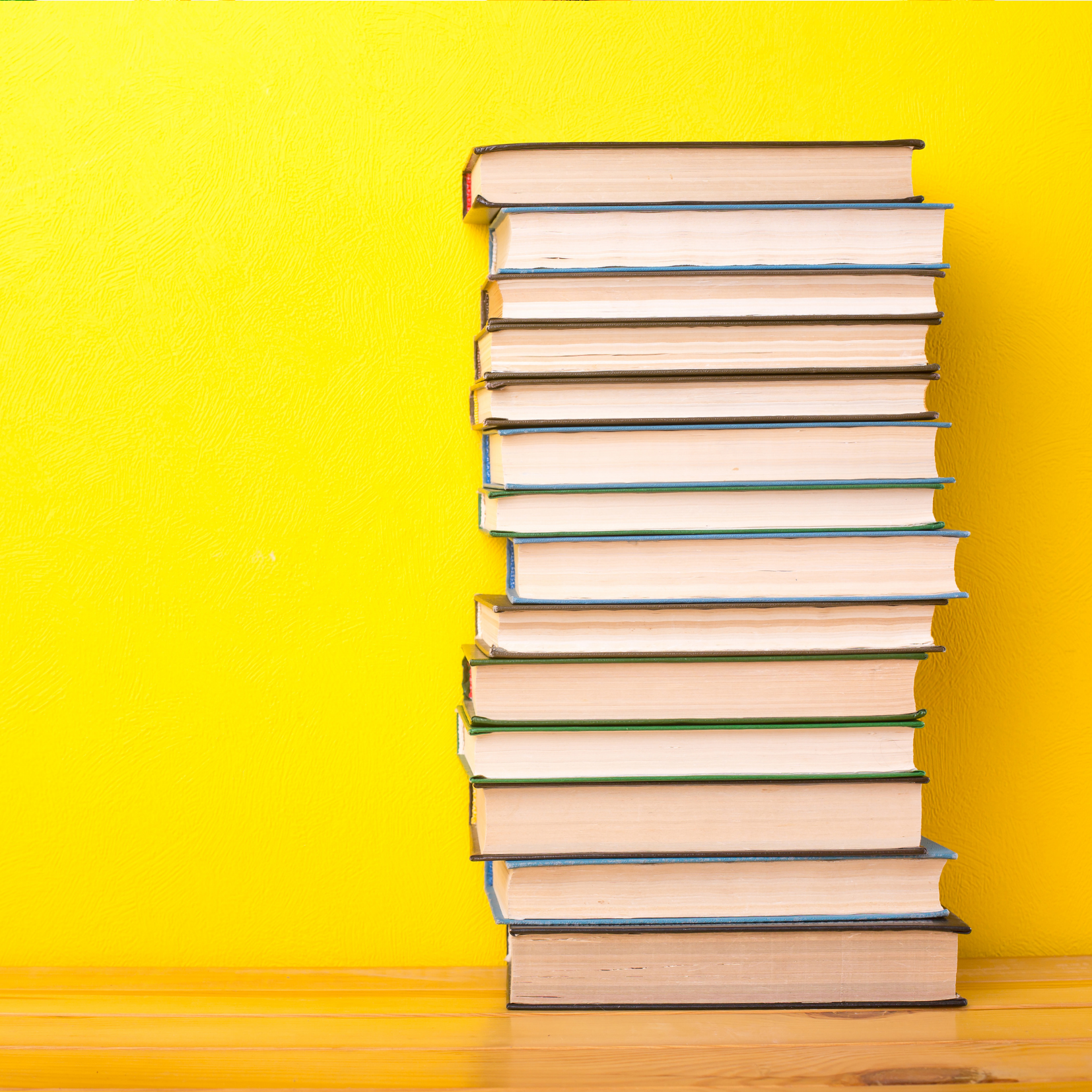 Stack of books on yellow background depicting Consulting