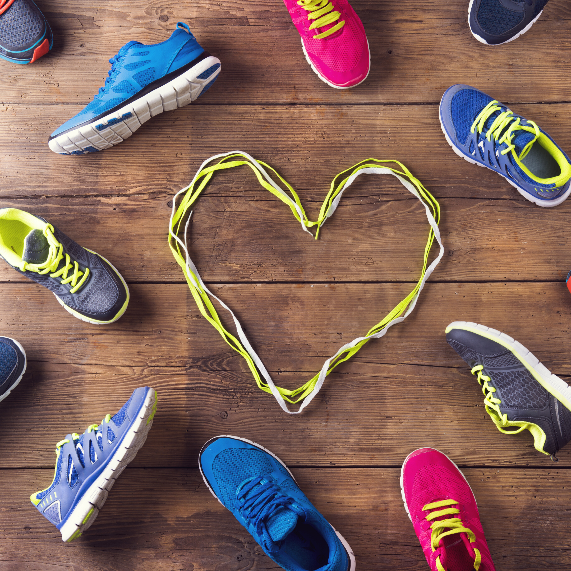 Sneakers on floor with heart in the center made of laces depicting Sports Nutrition