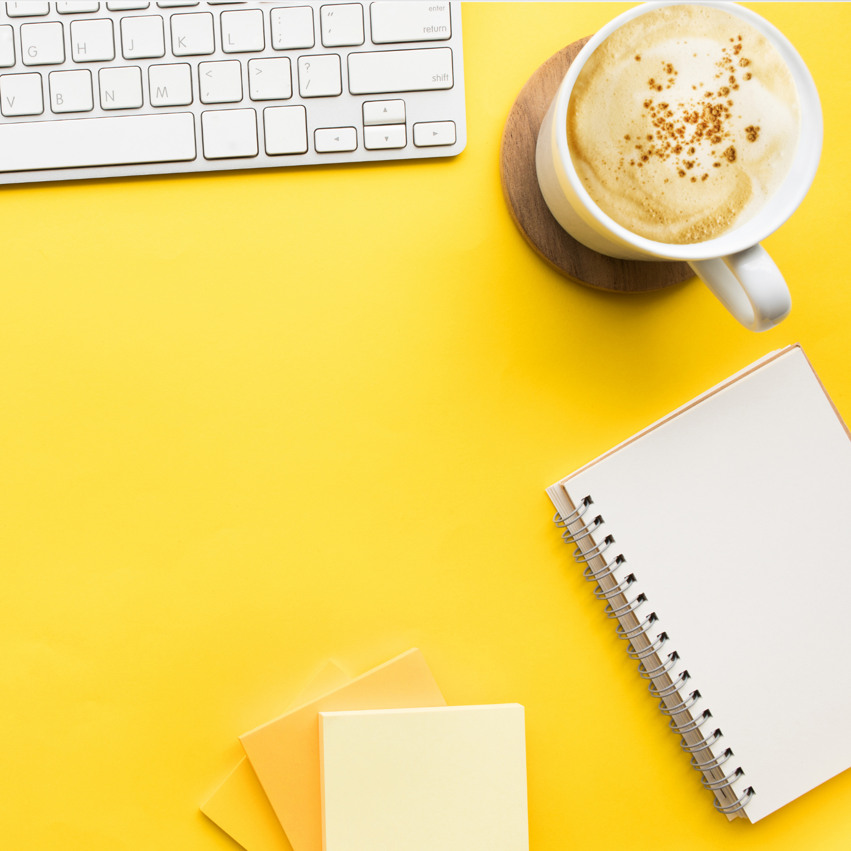 Coffee, Notebook & Keyboard on Yellow Background depicting Consulting for Van Dusen Nutrition